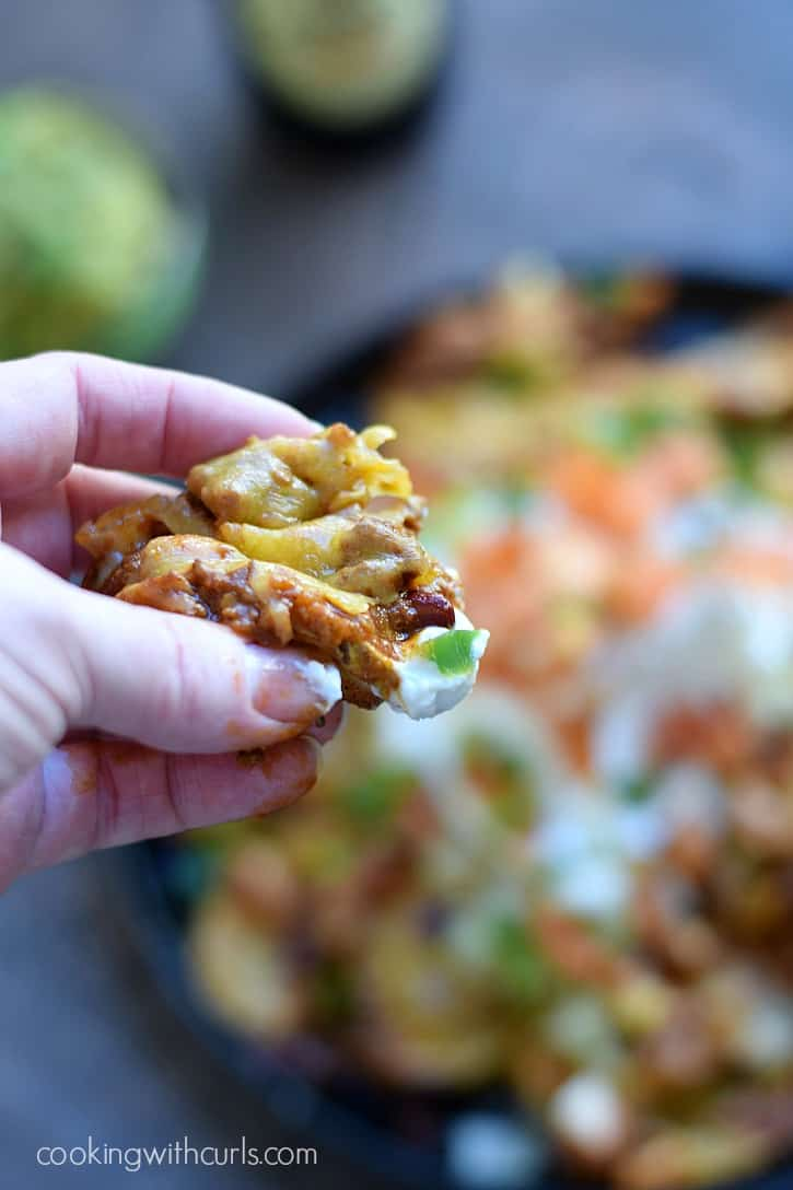 Irish Chili Nachos - seasoned, baked potato slices topped with Guinness Chili, cheddar cheese, salsa and sour cream for the perfect appetizer | cookingwithcurls.com