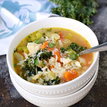 Warm up this winter with a big bowl of Chicken and Rice Soup, loaded with carrots, kale, and tomatoes   cookingwithcurls.com