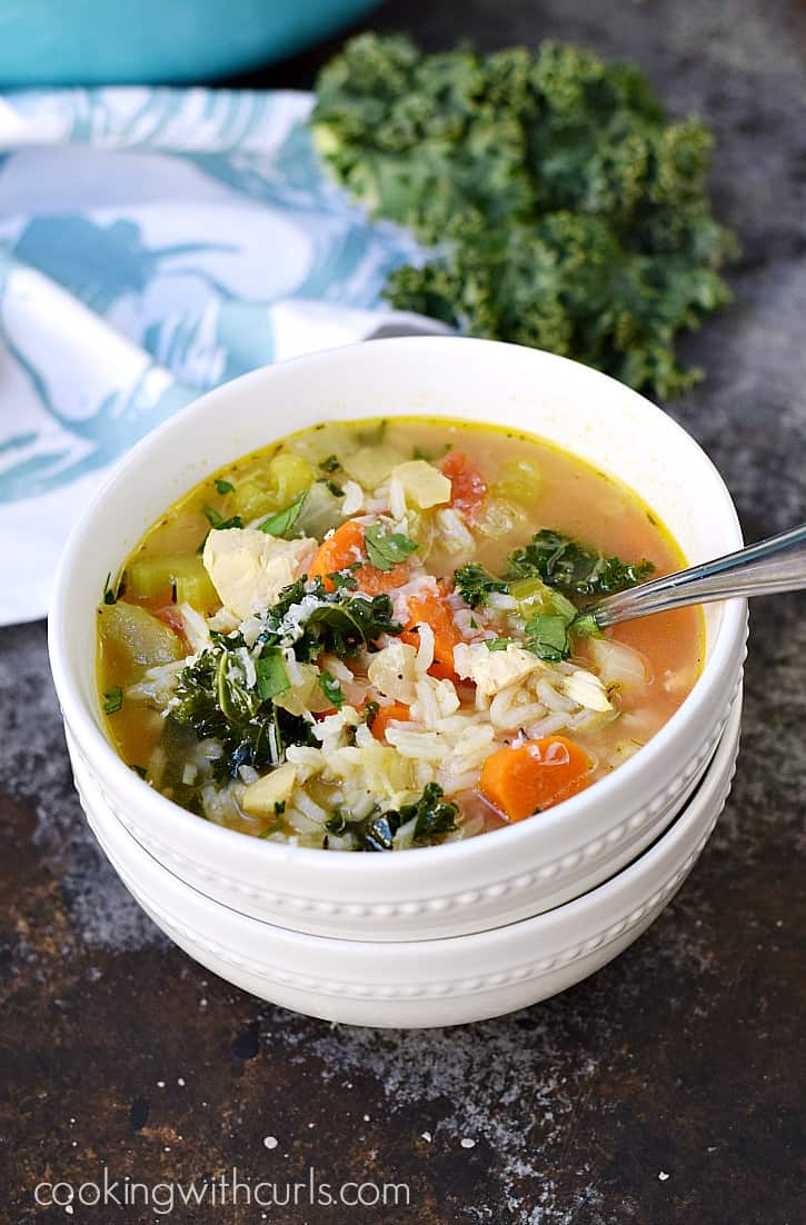 Warm up this winter with a big bowl of Chicken and Rice Soup, loaded with carrots, kale, and tomatoes | cookingwithcurls.com