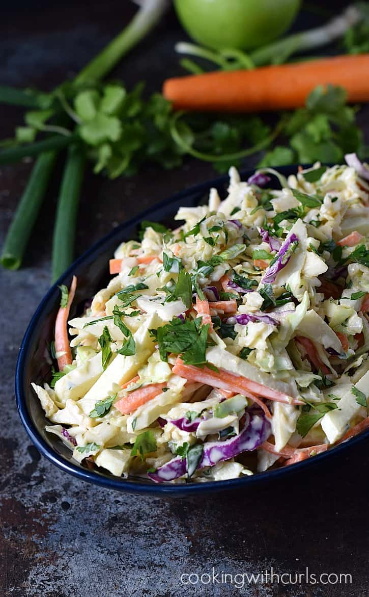 Crunchy, sweet and tangy Apple Coleslaw is the perfect topping for chicken and pork sandwiches | cookingwithcurls.com