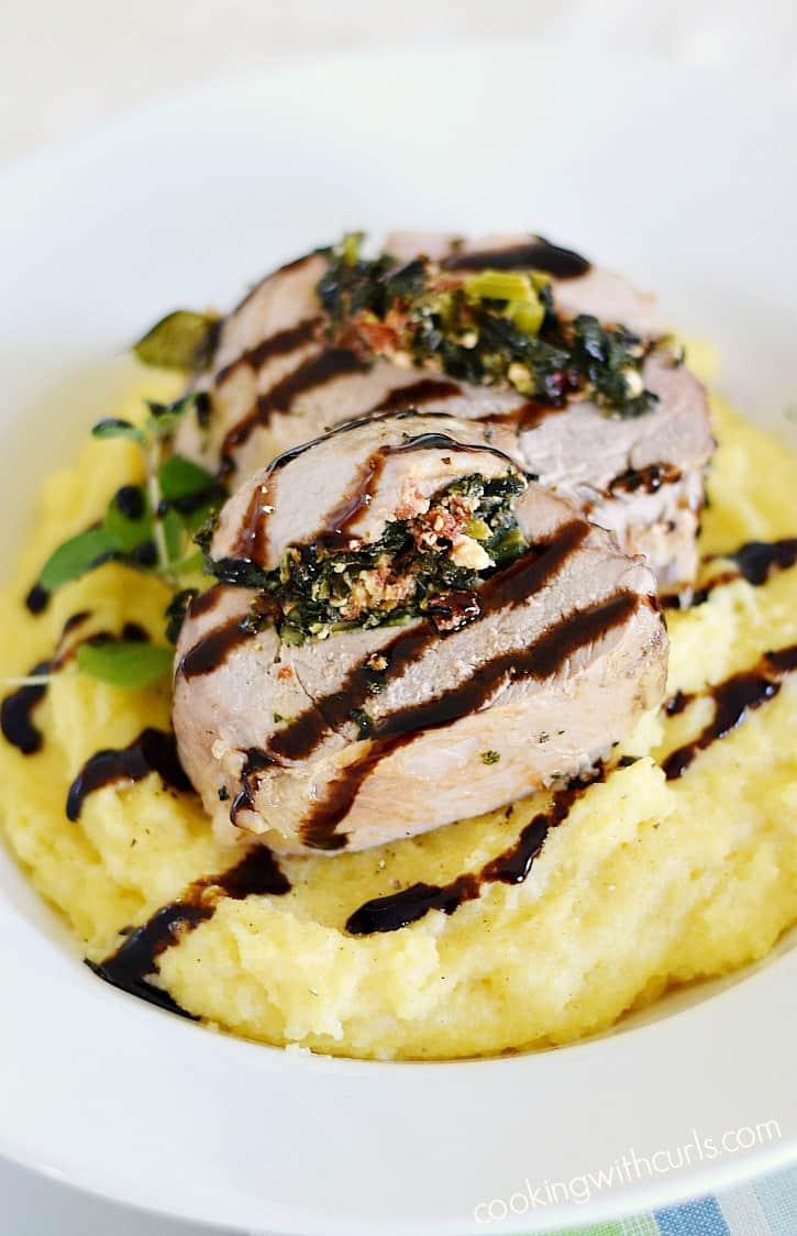 Moist and tender Tuscan Stuffed Pork Loin served on a bed of creamy polenta and drizzled with balsamic glaze that is perfect for any special occasion cookingwithcurls.com #EntertainandPair #ad