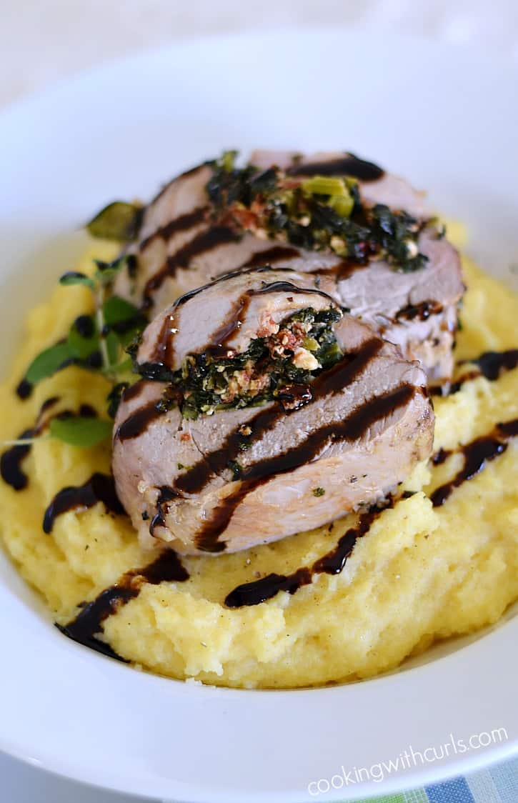 Msg 4 21+ Moist and tender Tuscan Stuffed Pork Loin served on a bed of creamy polenta and drizzled with balsamic glaze that is perfect for any special occasion | cookingwithcurls.com #EntertainandPair #ad