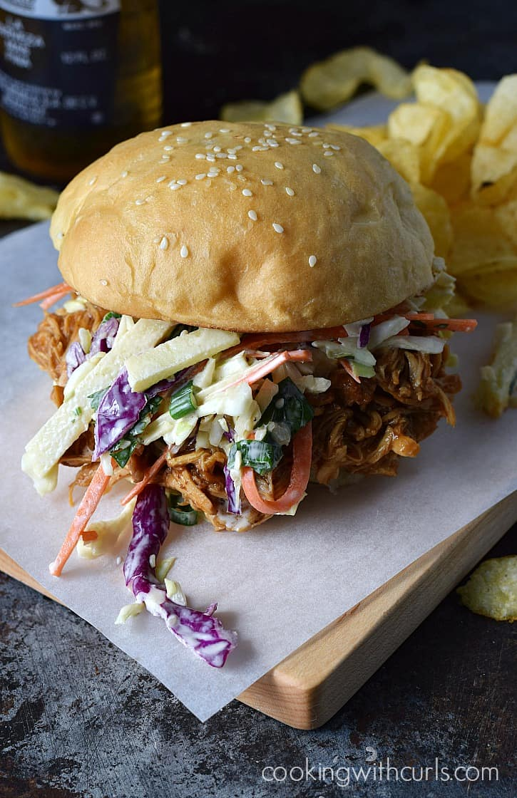 Slow Cooker Shredded Barbecue Chicken Sandwiches topped with Apple Coleslaw | cookingwithcurls.com