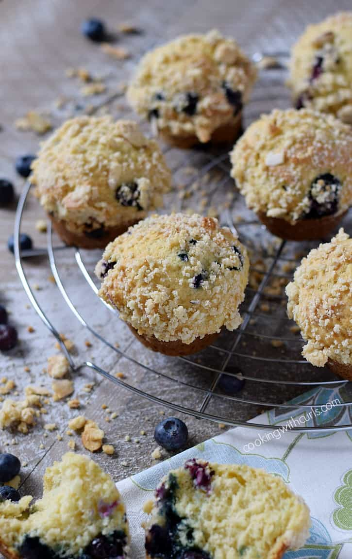 Bakery Style Blueberry Muffins bursting with ripe blueberries and topped with a crumbly almond topping. The perfect breakfast treat | cookingwithcurls.com