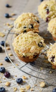 Bakery Style Blueberry Muffins topped with almond streusel! cookingwithcurls.com