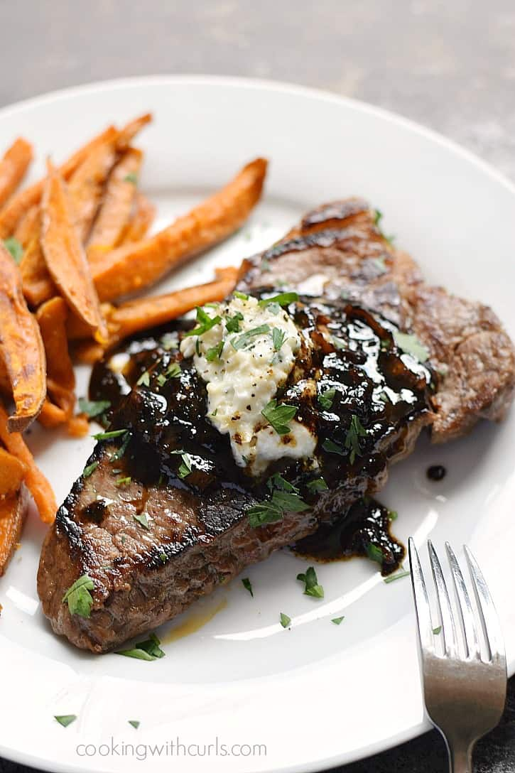 Pub-Style Steak with caramelized shallots and roasted garlic, goat cheese, and chives butter - So Delicious!! cookingwithcurls.com