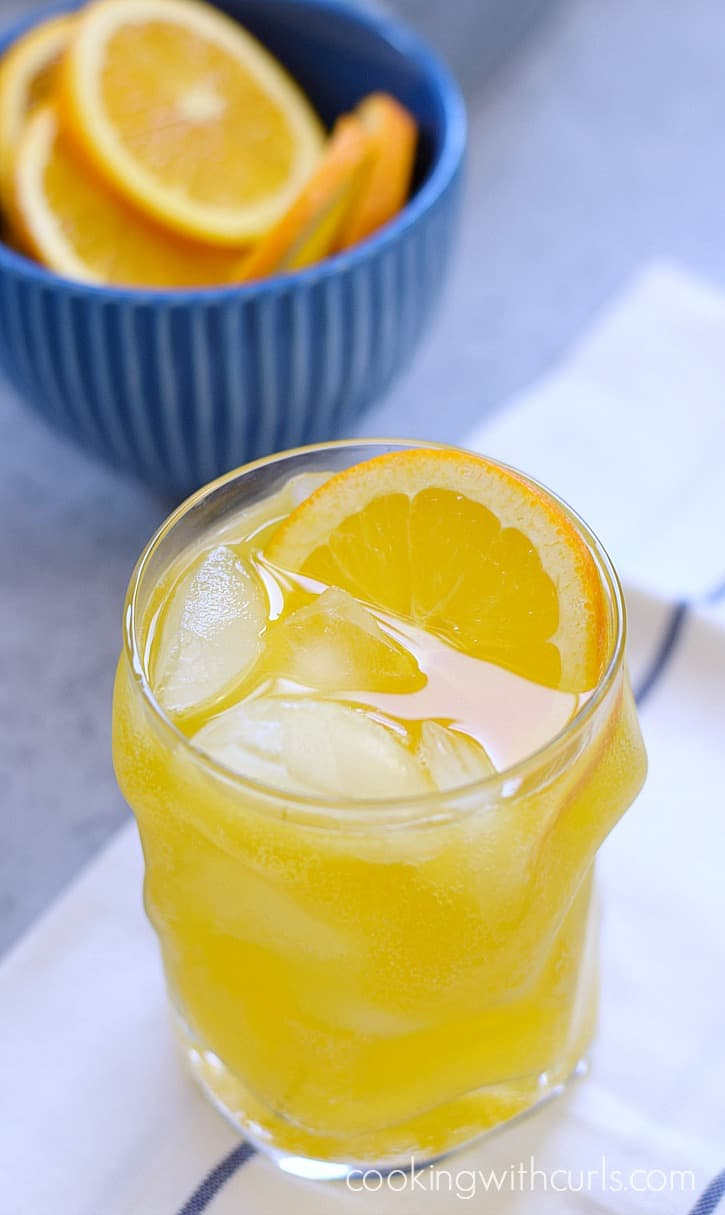 A light and refreshing Orange Peach Mango Spritzer just in time for summer | cookingwithcurls.com