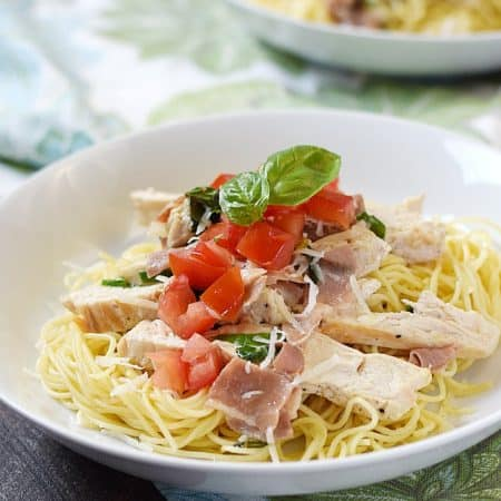 Fresh tomatoes and basil make this quick and delicious Chicken with Basil Cream on Angel Hair Pasta a perfect summer meal | cookingwithcurls.com