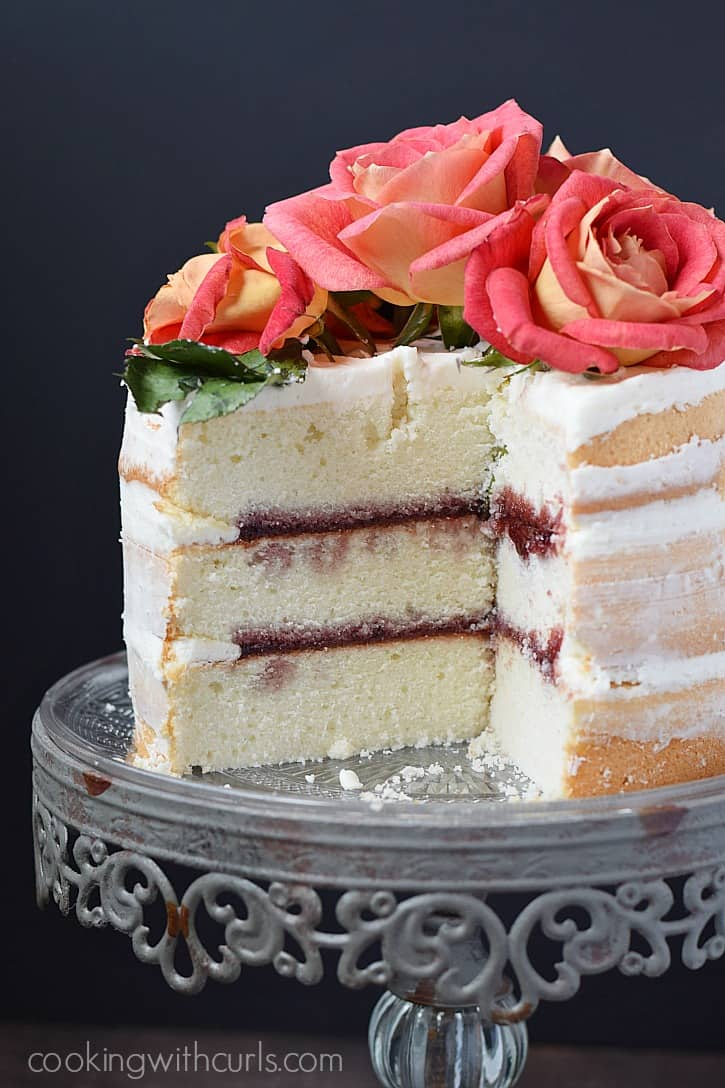 Naked 3-Layer Cake filled with raspberry preserves and homemade buttercream | cookingwithcurls.com