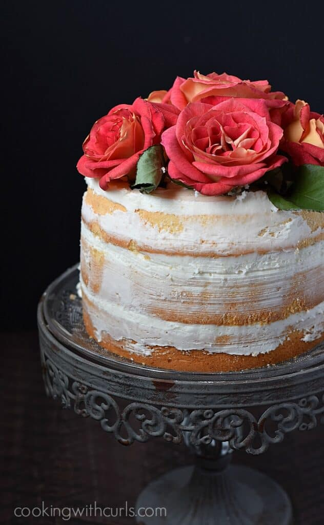 Naked 3-Layer Cake topped with roses and perfect for any special occasion   cookingwithcurls.com