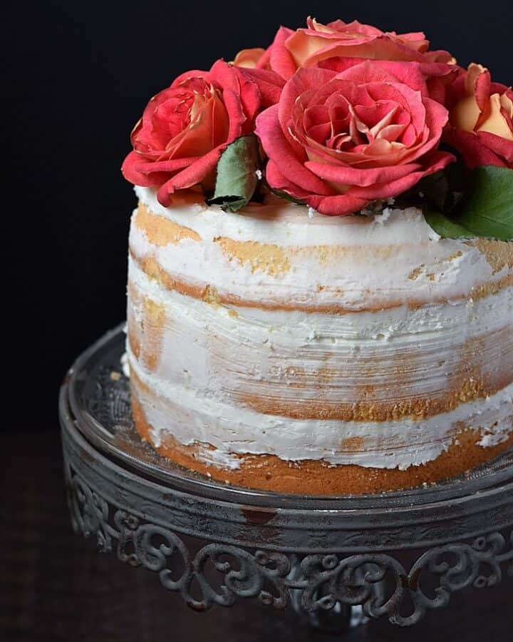Naked 3-Layer Cake topped with roses and perfect for any special occasion | cookingwithcurls.com