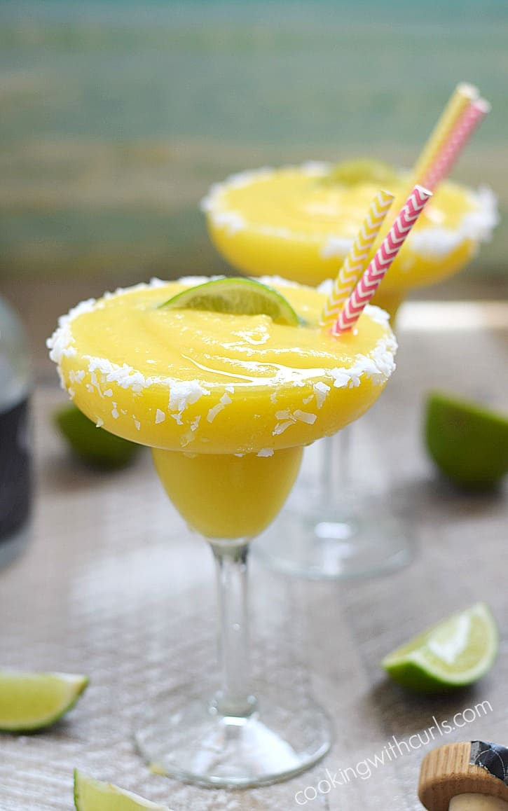 These Frozen Tropical Margaritas are like sunshine and ocean breezes in a coconut rimmed glass   cookingwithcurls.com