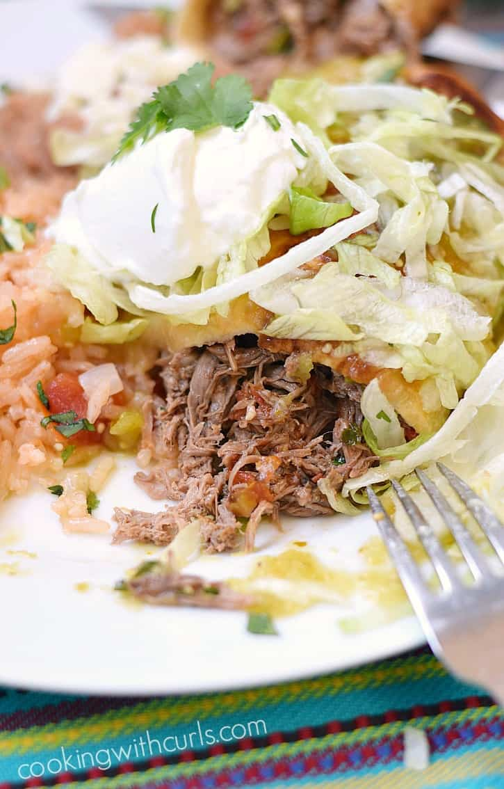 These Shredded Beef Chimichangas are stuffed full of flavor and easier to make than you might think!! cookingwithcurls.com
