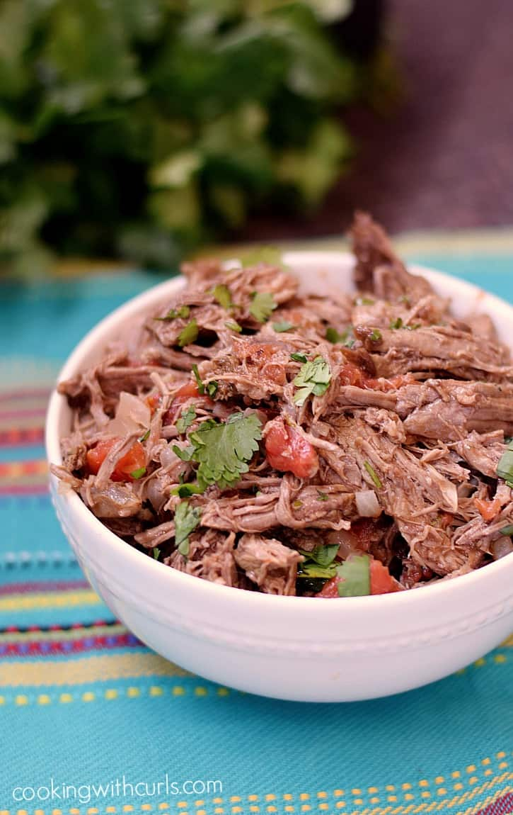 This Mexican Shredded Beef makes the perfect filling for tacos, burritos, and chimichangas | cookingwithcurls.com