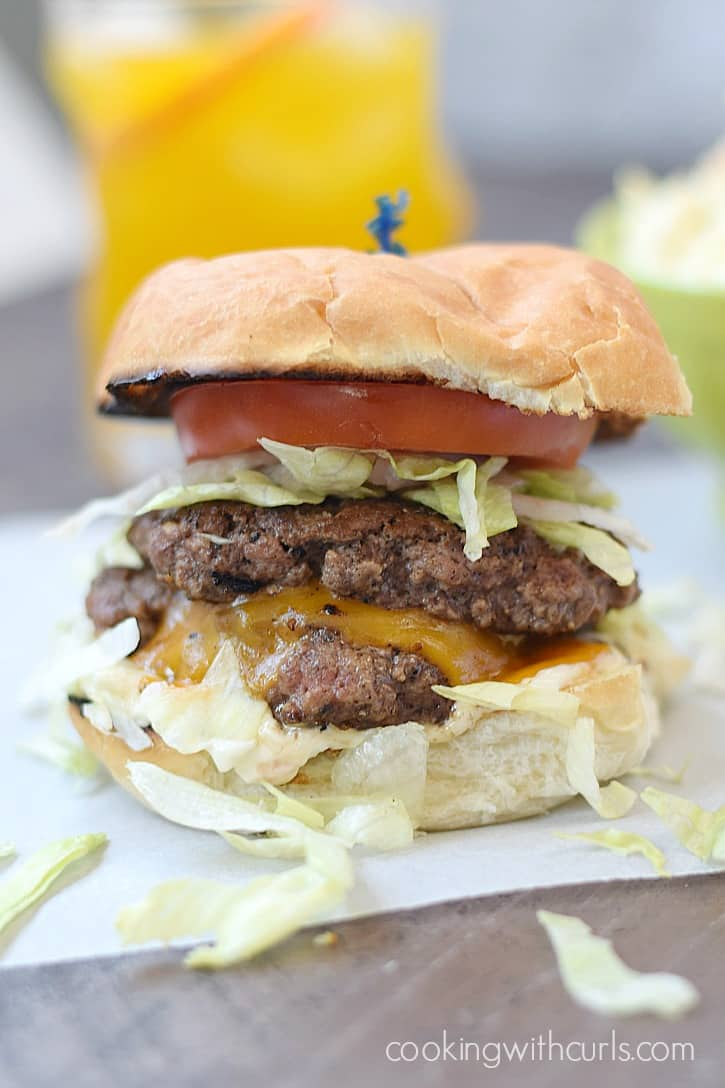 Amazing Smashed Burgers layered with cheese and flavor | cookingwithcurls.com