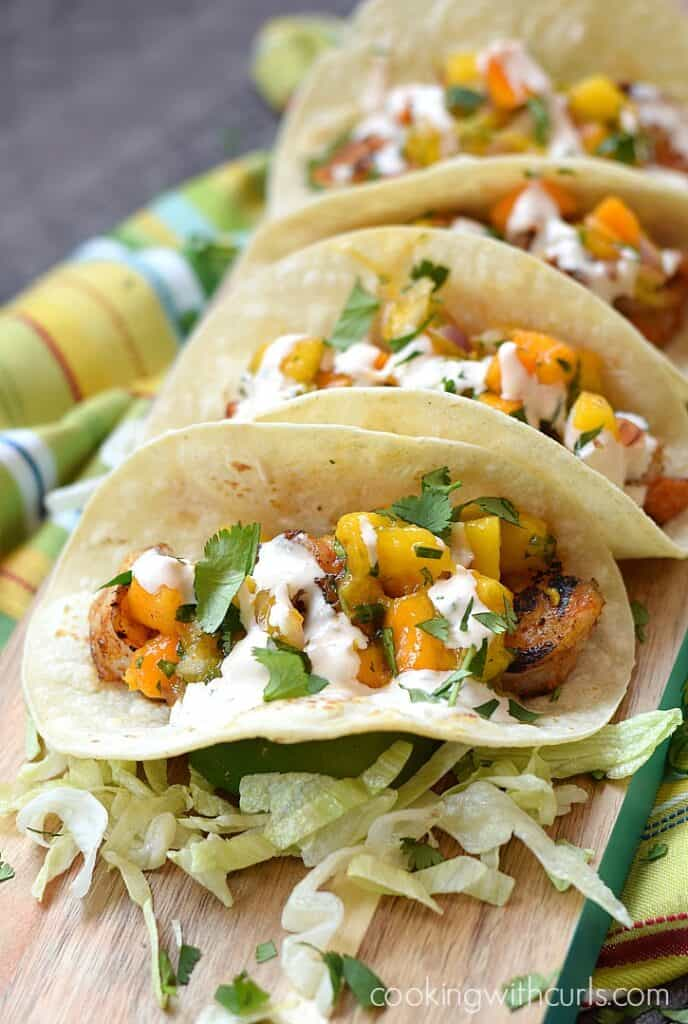 Grilled Shrimp Tacos topped with fresh Mango Papaya Salsa and chipotle crema   cookingwithcurls.com