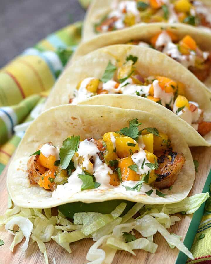 Grilled Shrimp Tacos topped with fresh Mango Papaya Salsa and chipotle crema | cookingwithcurls.com