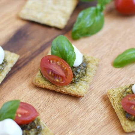 Impress your guests with these fun and delicious TomatoPestoCheesecuit {aka Caprese Bites} appetizers at your next dinner party | cookingwithcurls.com #ad #MadeForMore #Walmart