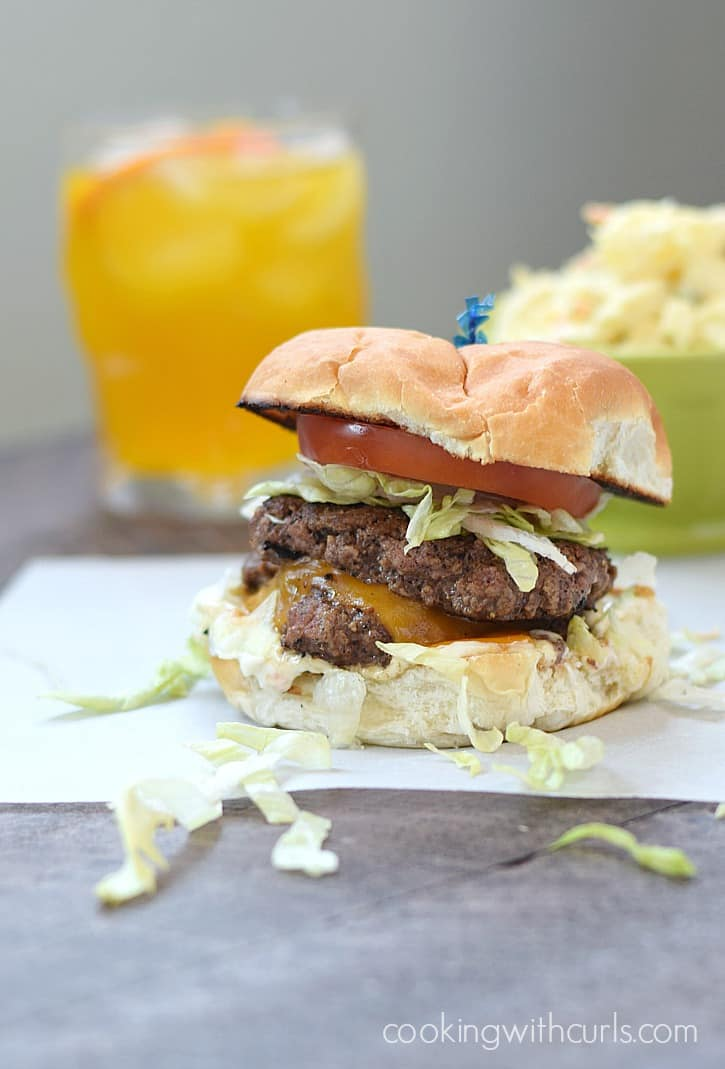 These amazing Smashed Burgers are simple to make, loaded with flavor, and make going to a burger joint disappointing | cookingwithcurls.com
