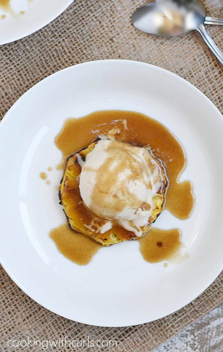 Grilled Pineapple Sundaes topped with vanilla ice cream and coconut rum caramel sauce | cookingwithcurls.com
