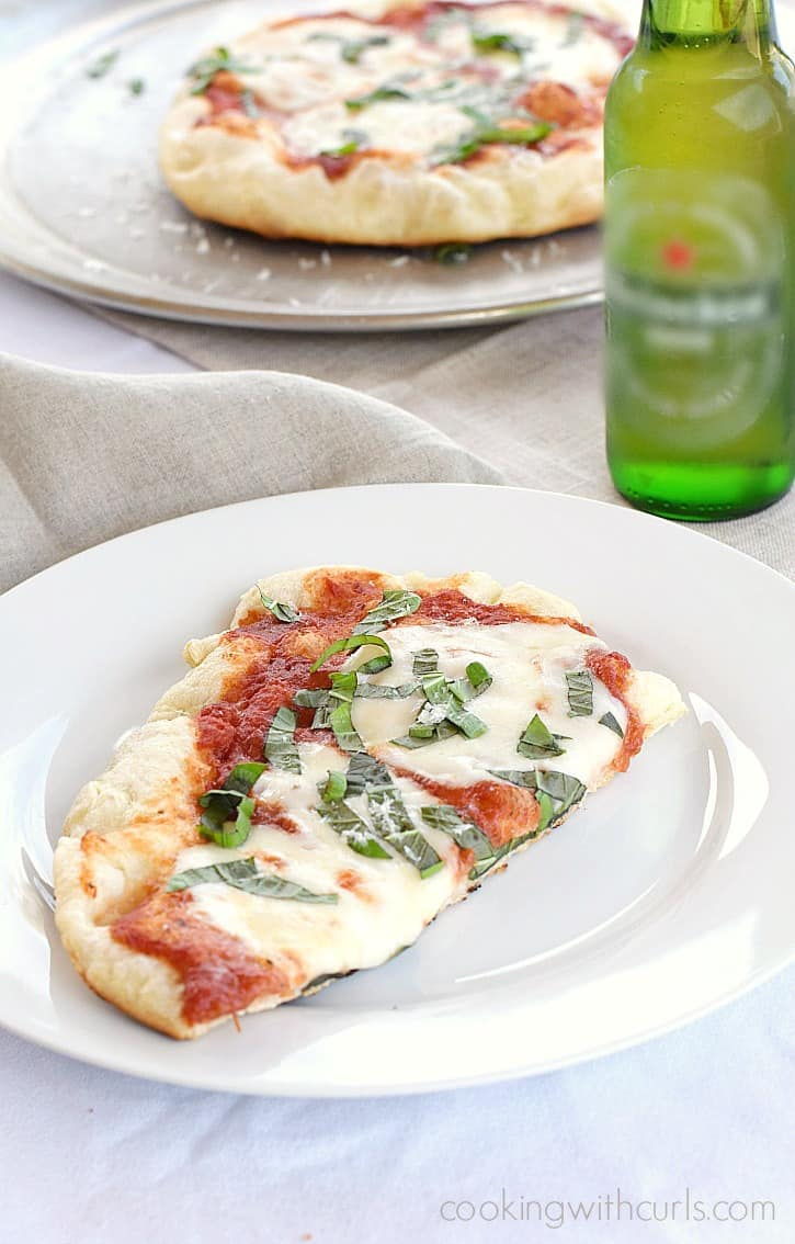 Grilled Pizza Margherita is perfect for summer parties! cookingwithcurls.com