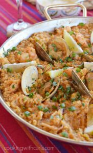 Msg 4 21+ Shrimp, clams, and all of their friends mix perfectly together in this delicious Seafood Paella | cookingiwthcurls.com #ArtofEntertaining #ad