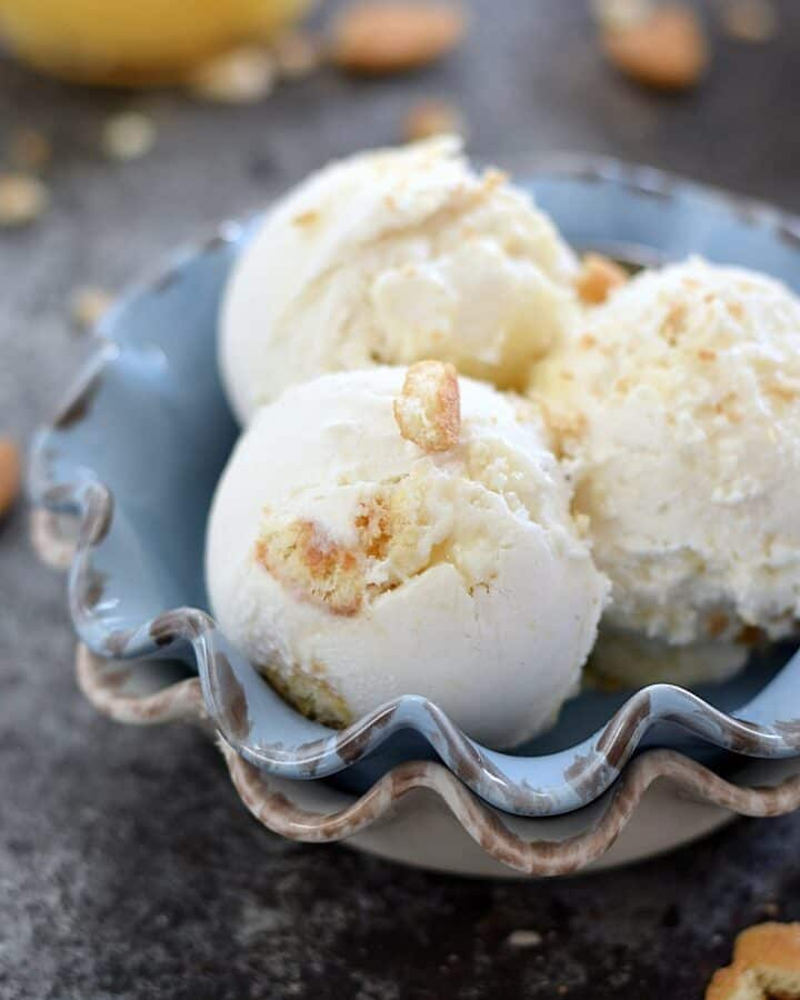 Sweet vanilla ice cream with swirls of lemon curd and vanilla wafers make this Lemon Cheesecake Ice Cream a delicious summer treat | cookingwithcurls.com