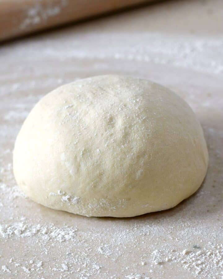 Traditional Italian Pizza Dough made from scratch for the perfect light and airy pizza | cookingwithcurls.com