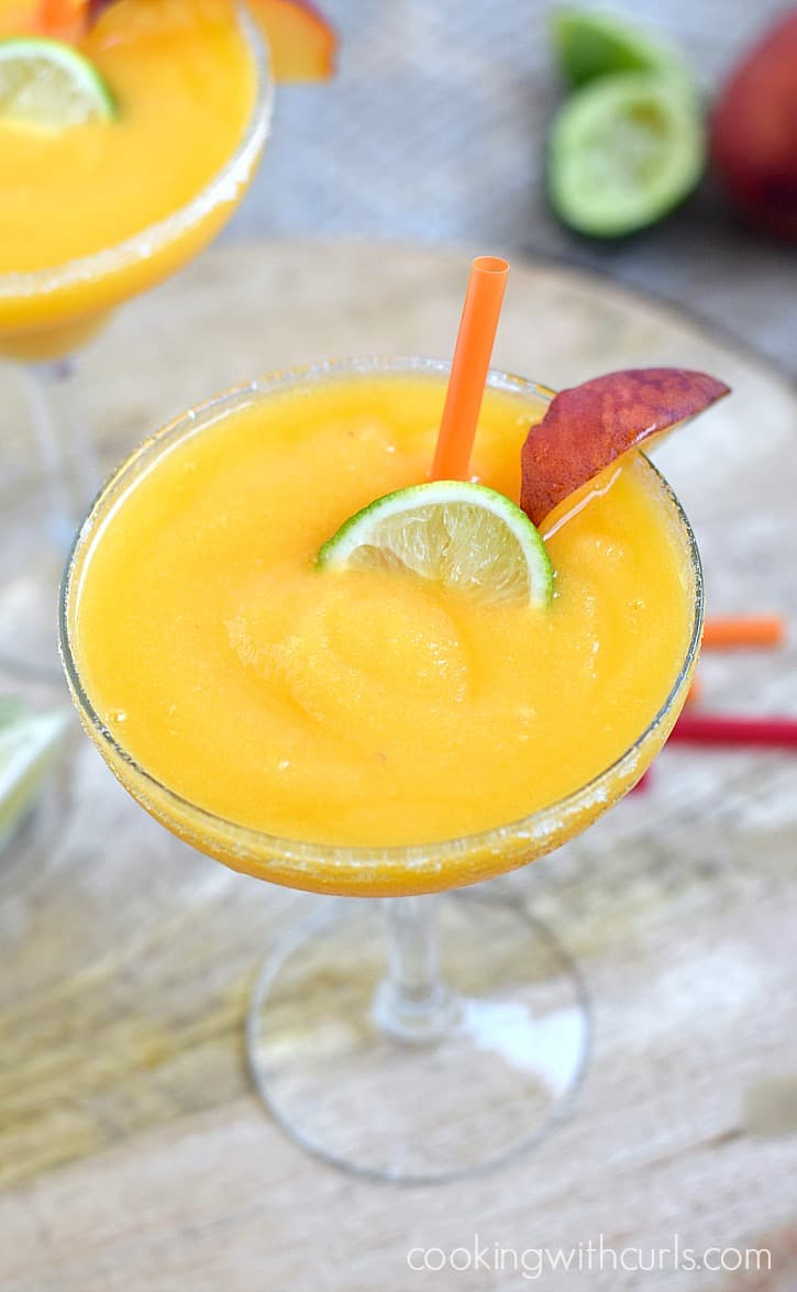 Your next fiesta needs a few of these delicious Frozen Peach Margaritas | cookingwithcurls.com