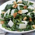 A delicious Black Kale Salad with a light dressing, topped with shaved Parmesan and whole wheat croutons is the perfect light summer meal | cookingwithcurls.com