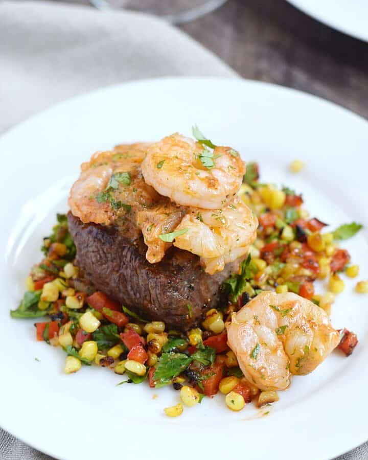 Beef Tenderloin on a bed of Grilled Corn Relish, topped with Tomato Butter for the ultimate Dinner for Two | cookingwithcurls.com