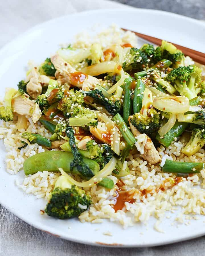 Chicken Teriyaki with broccoli, snap peas, and green beans topped off with teriyaki sauce and served with brown rice for a quick meal any night of the week cookingwithcurls.com