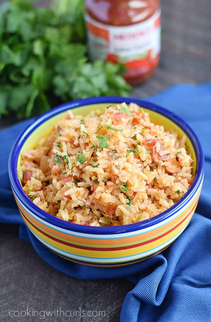 This super simple Salsa Spanish Rice gives you all the flavor of restaurant rice without all of the chopping | cookingwithcurls.com #AuthenticSalsaStyle #ad
