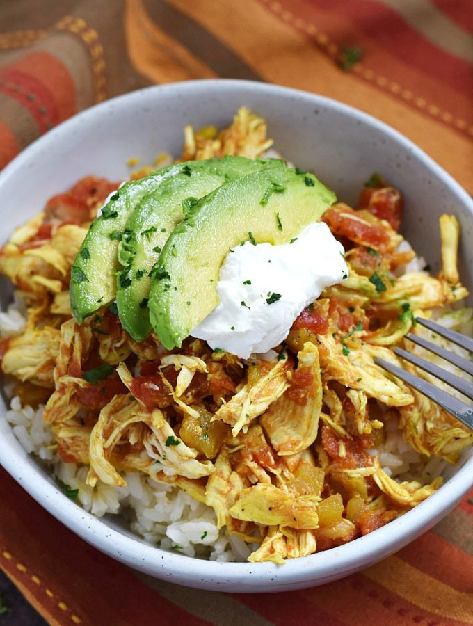 Adobo Slow Cooker Chicken served over rice and topped with Greek yogurt and avocado | cookingwithcurls.com
