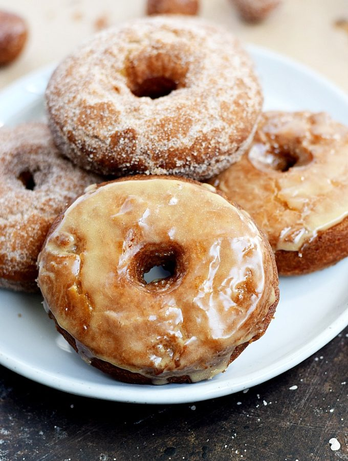 Apple Cider Doughnuts that are light and fluffy on the inside, and crispy delicious on the outside draped in glaze or cinnamon sugar | cookingwithcurls.com