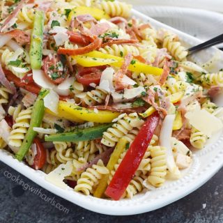 What is Antipasto Salad? Salami, pepperoni, roasted turkey, bell peppers, and rotini tossed in a light homemade Italian dressing for the perfect light lunch | cookingwithcurls.com