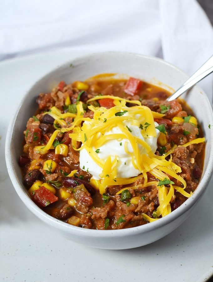 There's nothing better than a hearty bowl of Southwest Chili with Black Beans and Corn on a cold winter day | cookingwithcurls.com