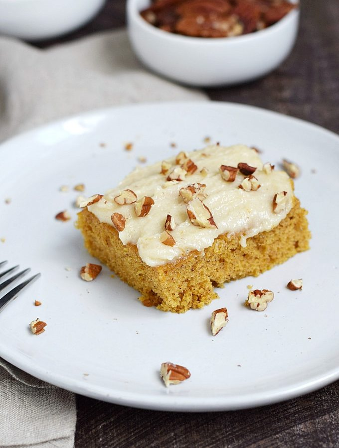 These Pumpkin Spice Bars have a cake-like texture and are topped with a maple frosting and toasted pecans | cookingwithcurls.com