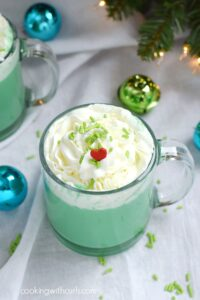Keep warm during the holidays with a Naughty or Nice Grinch Hot Chocolate | cookingwithcurls.com