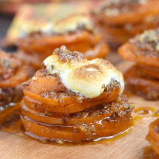 Stacks of sweet potato slices topped with pecans and toasted mini marshmallows