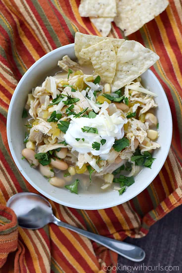 This Slow Cooker White Chicken Chili is the perfect meal to throw together and serve on a busy weeknight | cookingwithcurls.com