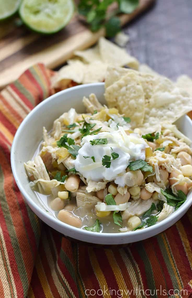 What could be better on a cold night than a big bowl of Slow Cooker White Chicken Chili? cookingwithcurls.com