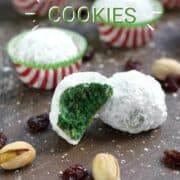 Four snowball cookies in red and white striped paper liners and two without surrounded by dried cranberries and pistachios with title graphic across the top.