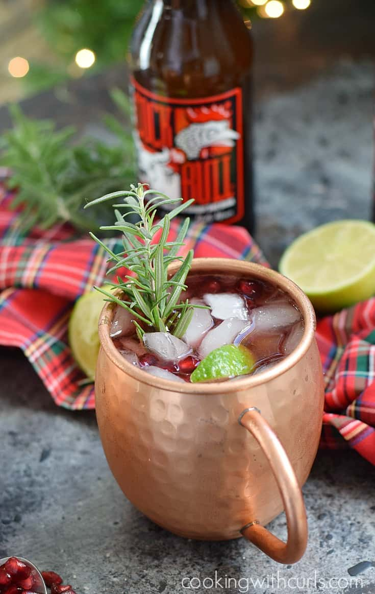 Spread holiday cheer this season and make some delicious Pomegranate Yule Mule cocktails for your family and friends | cookingwithcurls.com