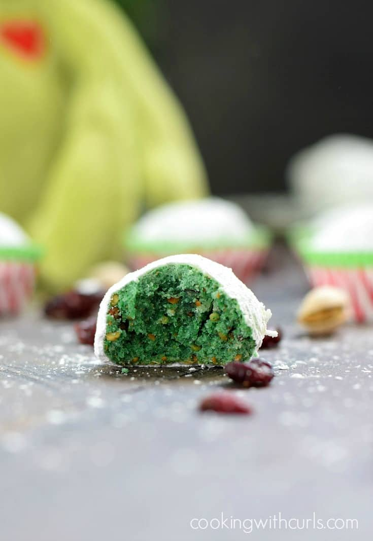 These Grinch Snowball Cookies are just as delicious as their cousin the Russian Teacakes, but get their flavor from pistachios and chopped cranberries | cookingwithcurls.com