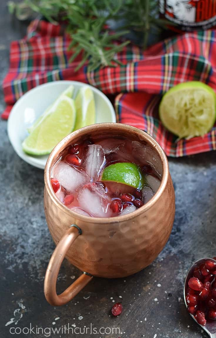 This Pomegranate Yule Mule is a fun twist on an old classic, and it's the perfect cocktail to serve during the holidays | cookingwithcurls.com