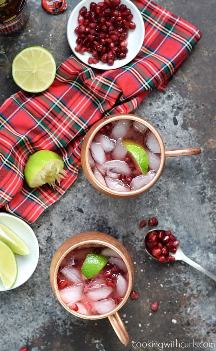 This Pomegranate Yule Mule is so simple to make, you just need pomegranate juice, vodka, ginger beer, limes ,and some ice for a the perfect holiday cocktail | cookingwithcurls.com