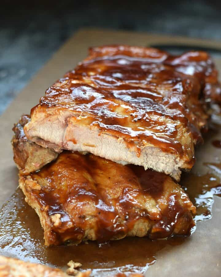 Instant Pot Barbecue Ribs stacked on top of each other on a cutting board