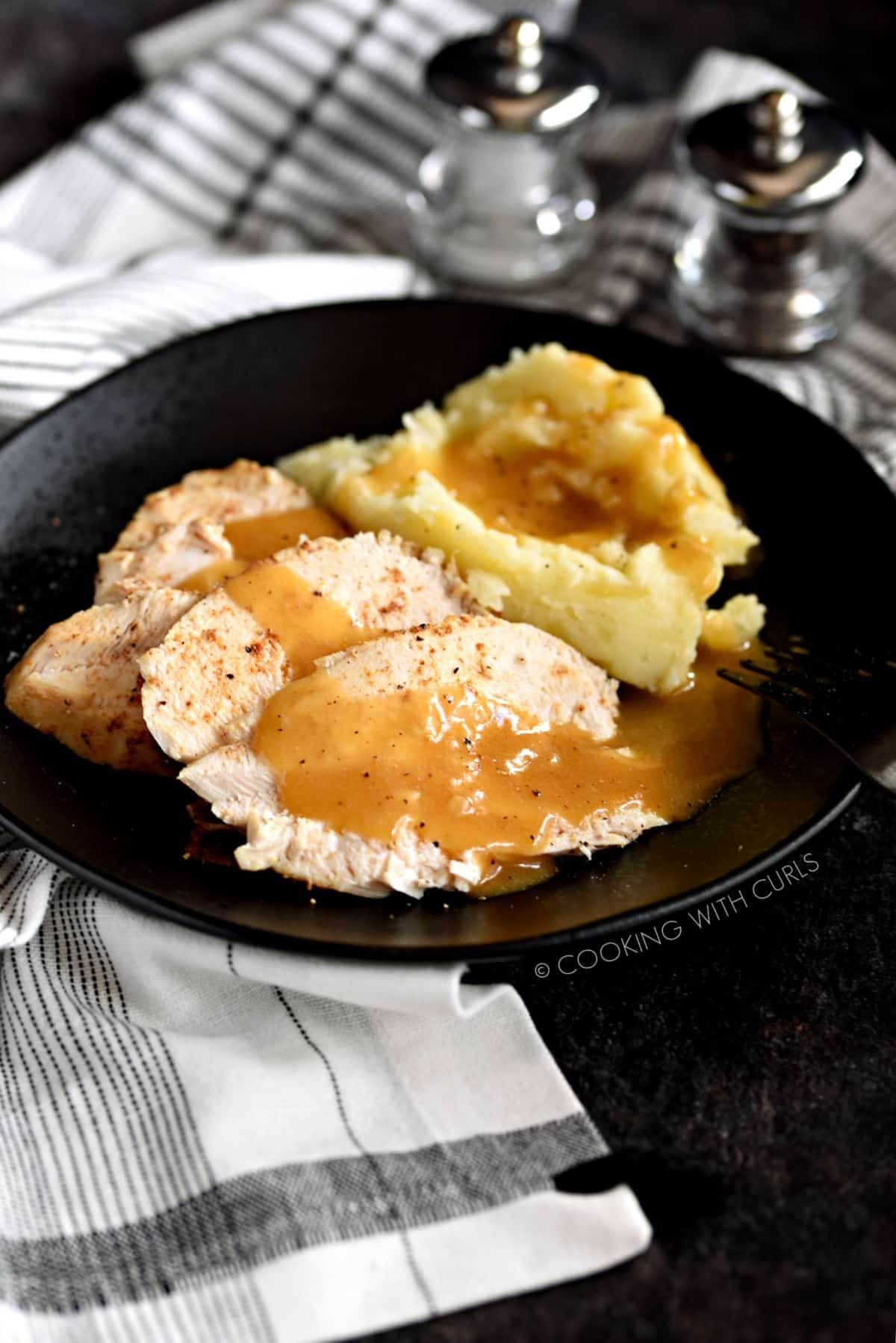 Sliced Faux-tisserie Chicken with mashed potatoes and gravy.