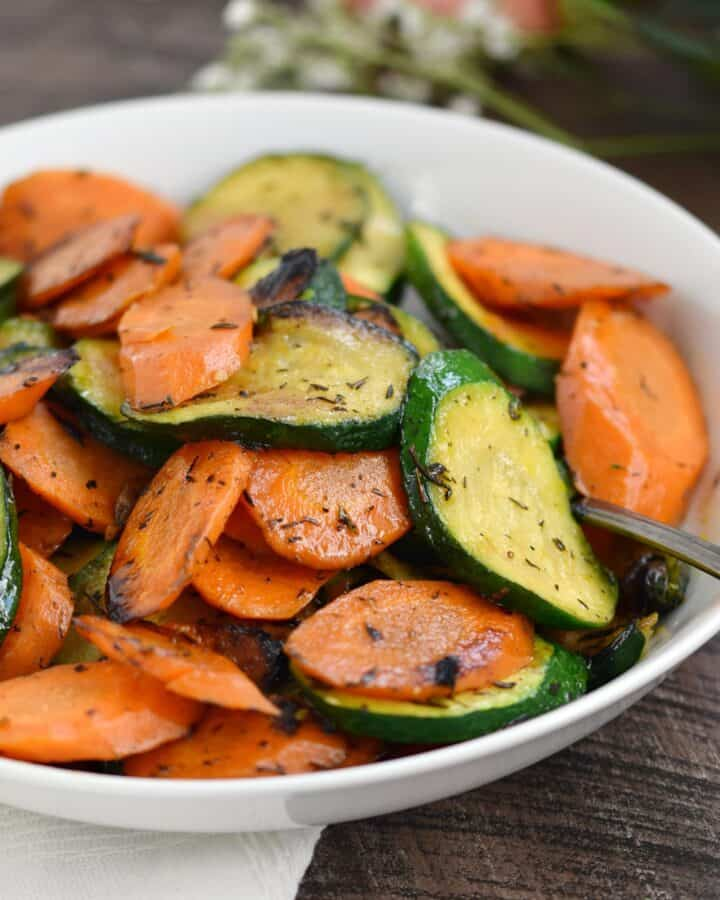 A white bowl of Easy Sauteed Zucchini and Carrots.